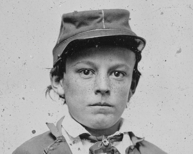 Unidentified young soldier in Confederate infantry uniform -  possibly drummer boy